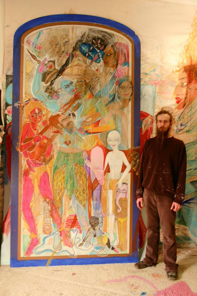 artist brian c baker with a couple of his interior mural size paintings